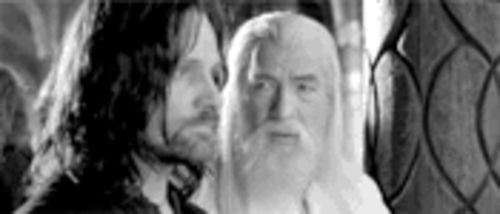 King-in-waiting Aragorn (Viggo Mortensen) counsels with wizard Gandalf (Ian McKellen).