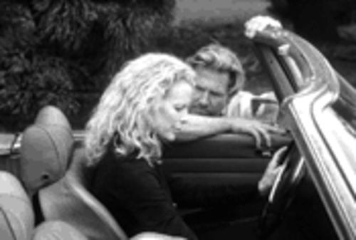 So close, yet so far: Jeff Bridges and Kim Basinger in The Door in the Floor