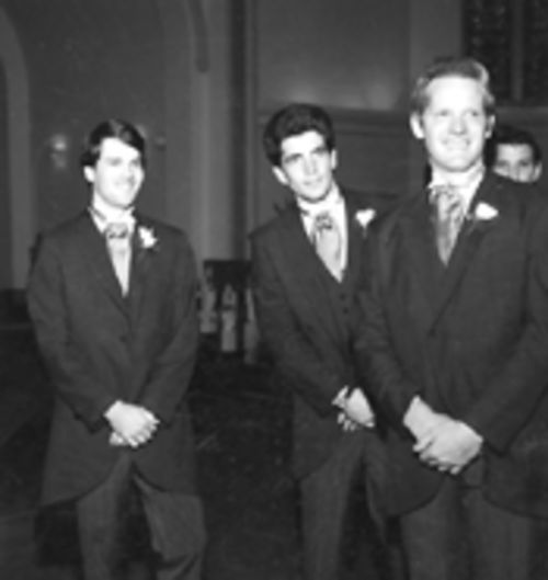 Littell, right, with JFK Jr., center
