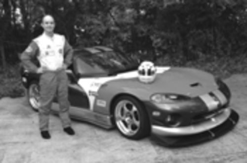 "MotorSport member Cris Schade with his ""mistress,"" a competition-class Dodge Viper"