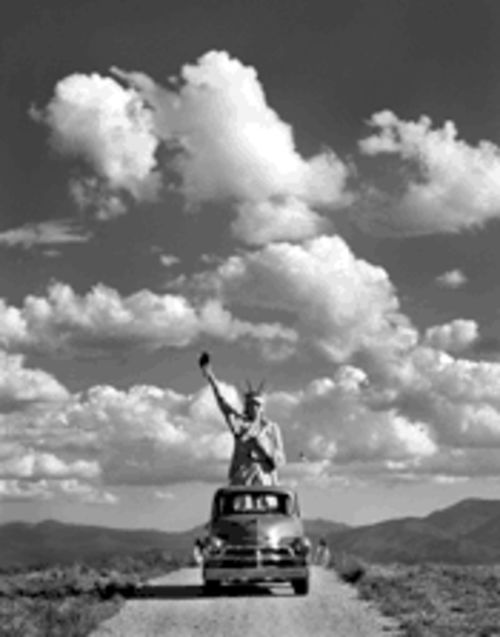 "Out of place: Lady Liberty takes a road trip in ""Sarah & Annie's Statue of Liberty, 2000"" from Out of Time: Photographs From the Ageless Landscape of Taos."