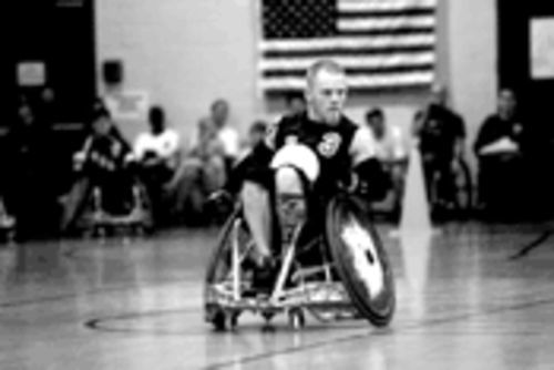 Mark Zupan, the Austin quad rugby warrior, will roll over your ass in a game of Murderball.