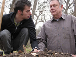 Drew Wall (left) and John S. Davies play two men who pulverize the remains found in coffins they disinter to make room for the newly dead. Good times.
