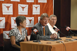 At a June 15 press conference, UT president William Powers (center) announced his school&amp;#146;s intention to remain in the Big 12. Big money played a big part in the decision.