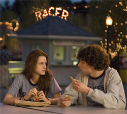 Jesse Eisenberg and Kristen Stewart share a moment of pre-history, way back in the Neolithic '80s.