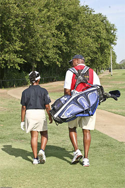 Steven Fleming walks the Lake Park Golf Course with a participant in his program.