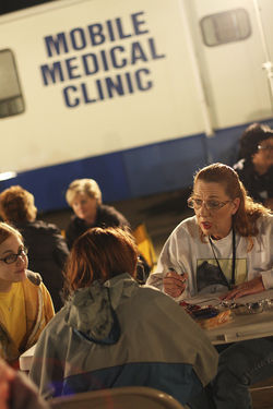 Counselors and public health workers screen the women at the command post, diverting many to drug re-hab.