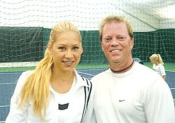 Actual photo: Anna Kournikova and Richie Whitt, as close as they'll ever get.