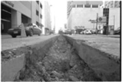 A trench runs through it: Dallas' street inspectors are overwhelmed by a mass of new street cuts for cables and pipelines.