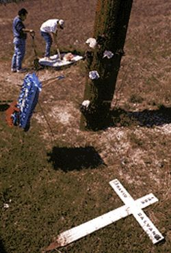 After more than six years, the weather-beaten cross, left, once erected in David Galvan's honor comes down, replaced by the new one his son Isaac Galvan built.