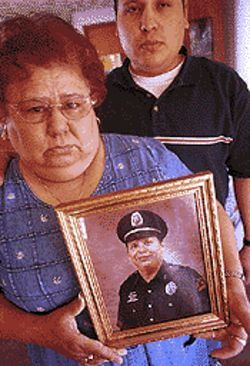 Lydia Galvan, with son Isaac, holds a picture of her late husband. Shortly after his father&#039;s death, Isaac named his newborn son David in his father&#039;s memory.