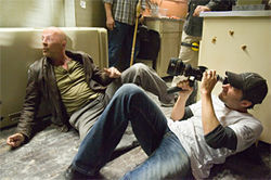 Director Len Wiseman frames Bruce Willis in Live Free or Die Hard.