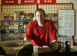 CD Source general manager Larry Hanover lords over crates of Ace of Base and more.