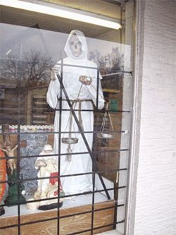 Santisima Muerte, patron saint of criminals, is for sale all over Dallas, including a statue for more than two grand.