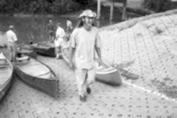 Canoe guide Charles Allen first noticed the bones found on the Trinity in August 2001, but he knew better than to dig them up.