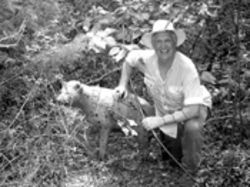 Kim Denton, a traditional archer from Fredericksburg, poses with his prey: an unidentified Styrofoam creature.