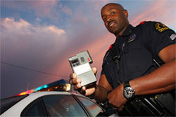 Dallas police Senior Corporal Bobby Watkins and his portable breath test: Officers like Watkins on the city's DWI task force take care in building cases against drunken drivers. They have to, thanks to lawyers like David Burrows.