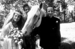 Arliss Howard, right, with a horse, some guy and Debra Winger beside him...insert your own joke here.