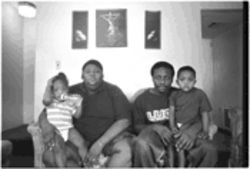 Mattie Davis (left) holds Alvin Ray Davis while Kevin Wingo holds Kevin Davis. The kids are Mattie's and Kevin's; Mattie Davis credits Murkledove for her staying in school.