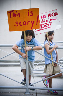 Christian Salinas, 8, and his sister Alexie, 9, students at Harry Stone Montessori Academy, join the protest.