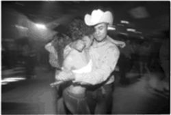 A couple dances to Escapade 2001's mix of more traditional Mexican music.