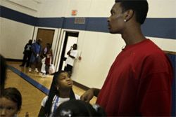 Finding dirt on Chris Bosh--here, doing the role model thing for some southern Dallas kids--is like finding clean on Ron Jeremy.