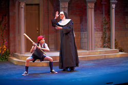 Nun funnier: Mary-Margarett Pyeatt as Timmy and Coy Covington as Mother Superior hit it out of the park in Uptown Players' The Divine Sister.