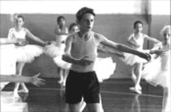 As Billy Elliot, Jamie Bell charms by dancing as fast as he can.