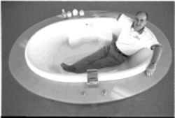 Russell Walker, a vice president of Sanijet Corp., in one of the company's pipeless tubs. The Coppell start-up claims it's built a better bathtub, a pipeless whirlpool that can be thoroughly cleaned.