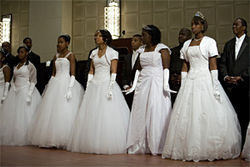 The young debutantes are introduced to the audience during the June 13 Junior Debutante Ball at the Hilton Anatole.