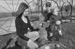 "Charlotte and James Scott, with their 13-month-old son MacKinnley, visit their son Matthew's grave. There is no headstone, but a marker on the grave says, ""No farewell words were spoken, no time to say good-bye, you were gone before we knew it, and only God knows why."""