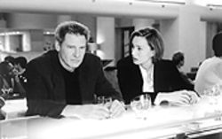 Harrison Ford and Kristin Scott Thomas share a drink: They should try coffee to stay awake through Random Hearts.