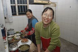 Dong Ging Mei and Dong Xiu Mei make dumplings in a Dawukou apartment.