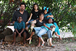 The Tutt family beneath the magnolia tree in front of their Duncanville home. Clockwise from left: Trevor, Emma, Bailey, Chaniya, Christina and James.