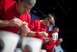 Top-ranked eaters Pat Bertoletti, center, and Joey Chestnut, right, joined Biller at this year's State Fair of Texas for a Jimmy John's sandwich-eating promotion. The state fair canceled its amateur corn dog eating contest this year as well.