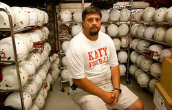 Justin Landers, trainer for Katy High (Houston), says new helmets reduce the risk of concussions.