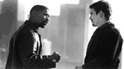 Ebony and ivory: Denzel Washington could teach Ethan Hawke a thing or two about police work and facial hair.