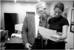 Haynes confers with Sharon R. Levine, one of the lawyers working in his Houston firm.