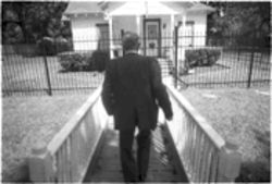 "Richard ""Racehorse"" Haynes approaches his boyhood home in Houston, which he recently purchased."