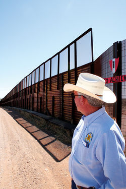 Cattle rancher John Ladd at the border in Palominas.