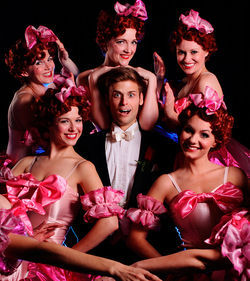 Sam Beasley plays aspiring hoofer Bobby Child, surrounded by showgirls in Theatre Three&#039;s Crazy for You.