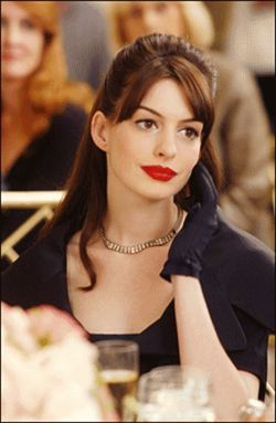 The Devil Wears Prada&#039;s Anne Hathaway wants to be a journalist for all the nifty clothes. Yeah, reporters are fashion plates. Sure they are.