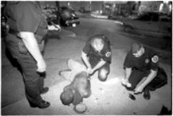 No shirt, no sobriety, no service: Texas Proforce officers Yvonne Dupont, Ron Eggleston and Brad Richey look for ID on a passed-out Deep Ellum patron.