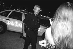"""Office Terry Peters listens to Twinkie's story at the Pilot truck stop. Peters--DPD's """"whore cop""""--talks to truck-stop prostitutes such as this one almost every night."""
