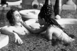 Hell on earth, with a little slice of heaven: Stuart Townsend and the late pop star Aaliyah take a dip in the Damned.