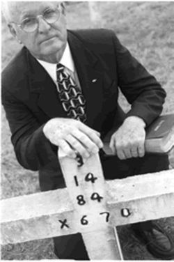 The Rev. Carroll Pickett at the headstone of James David Autry, one of 95 persons executed in Texas whose last moments were spent with Pickett.