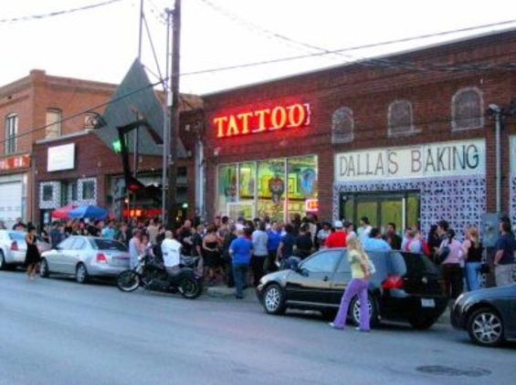 Friday the 13th and the packed sidewalk in front of Elm Street Tattoo