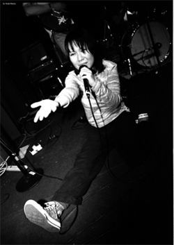 Satomi Matsuzaki does the vocals and the rock splits for Deerhoof.