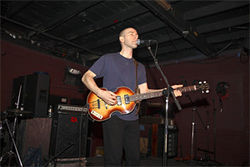 Fugazi's Joe Lally played Rubber Gloves in February. And we're above covering Denton more closely? Let's fix that.