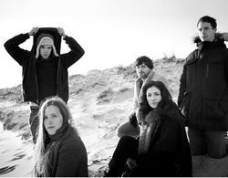 Dirty Projectors, just chillin' on a random beach.